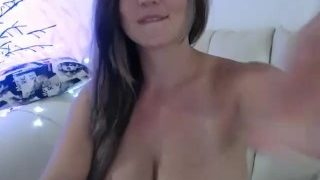 Nice smiling camgirl talking about surgery on her tits.